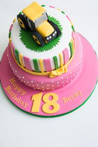 Pink JCB tractor birthday cake