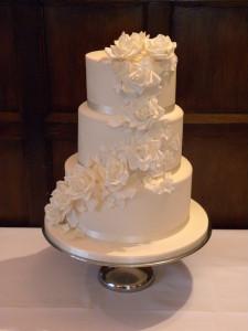 Wedding cake ivory romantic butterflies roses cascade petals