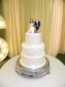 Elegant white ruffle wedding cake