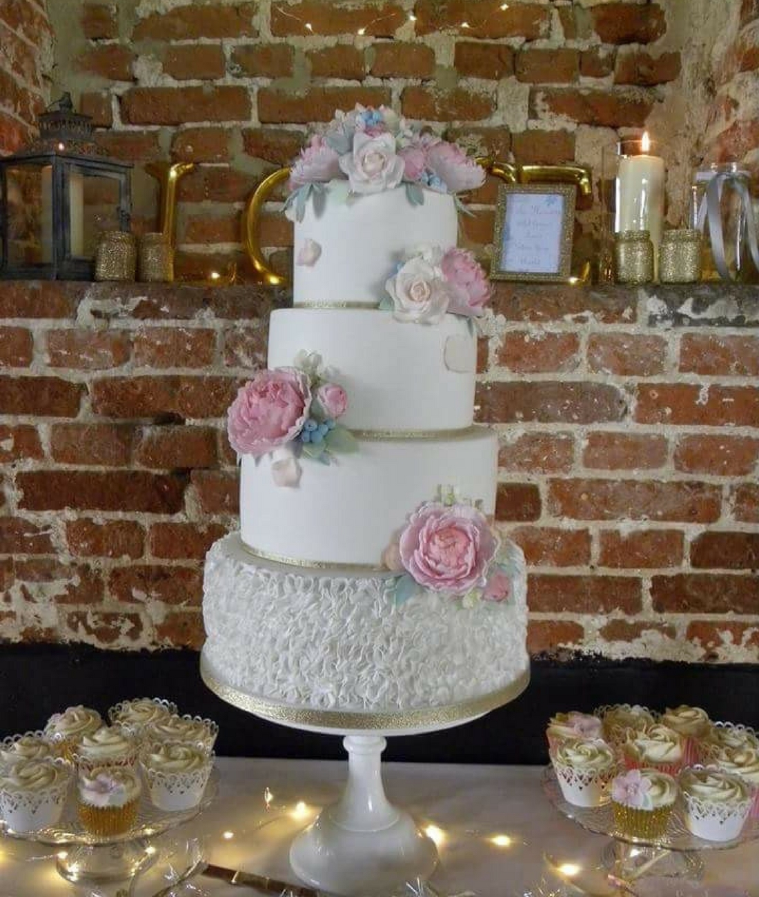 Love Artisan Wedding Cakes - Four Tier Floral White Ruffles Wedding Cake and Cupcakes