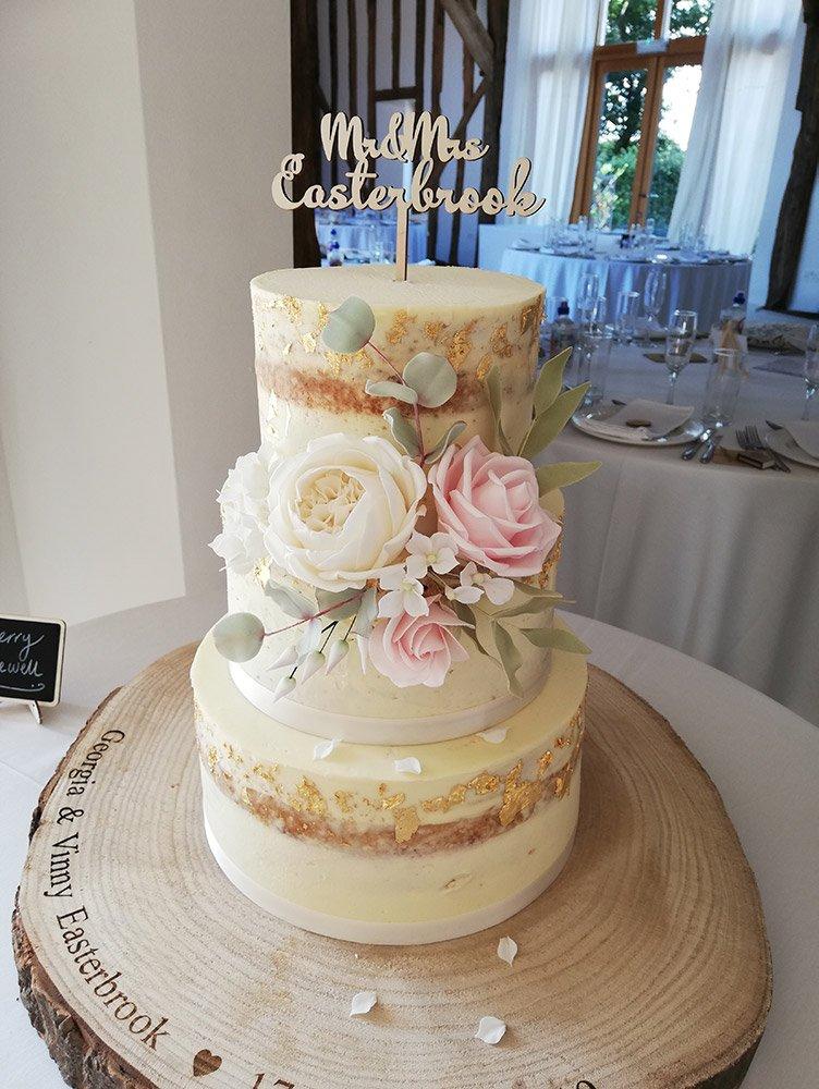 semi naked wedding cake with sugar flowers