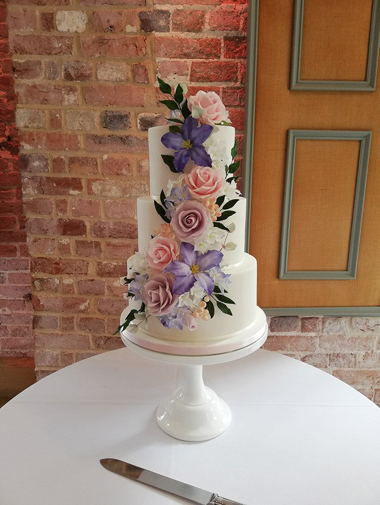 Floral cascade wedding cake with three tiers