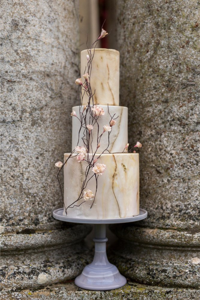 Natural stone marbled wedding cake with three tiers